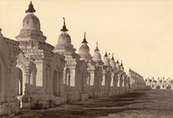 A picture taken within the enclosure of the 'Koo-thoo-daw', [Kuthodaw Mandalay], shewing some of the white shrine-like buildings